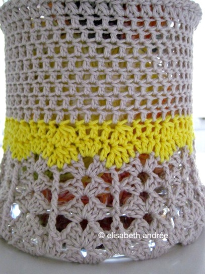 doily vase cover with a yellow wave
