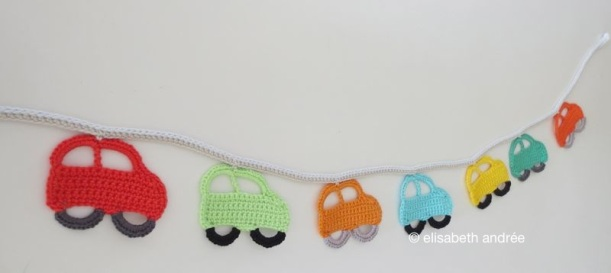 little cars in a row by elisabeth andrée