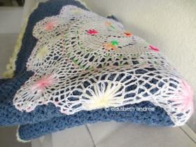 doily with embroidery stitches on sofa blanket