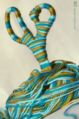 """yarn wraps scissors"""