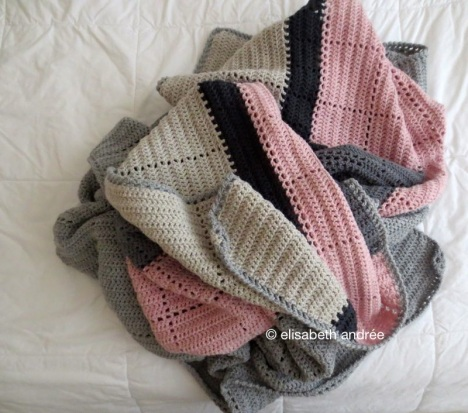 bedspread of grays, greige and pink