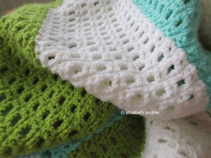 blanket made of strips in blue green white