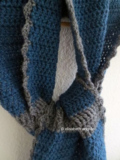 blue scarf with grey stripes and edge