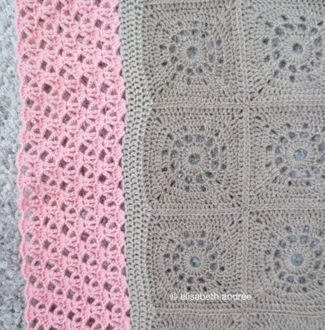 beige blanket with pink edge