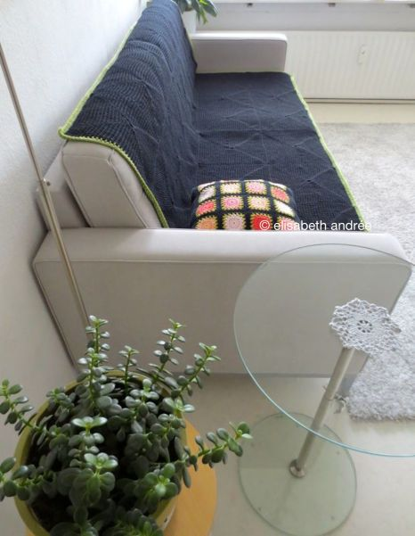 crochet black blanket on couch