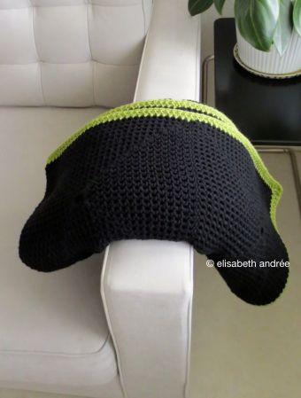 folded crochet black blanket
