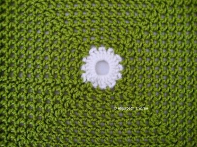 square of green with dots blanket