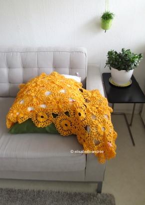 wip orange shawl blanket on couch