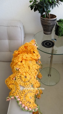 orange drape and black coaster