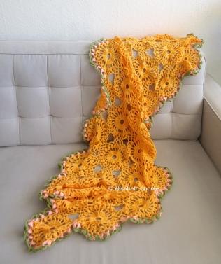 orange drape on couch