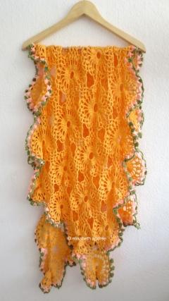 orange drape on hanger