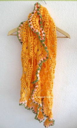 orange drape with pink and green edge