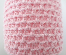 crochet pink jar cover close up