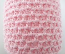 crochet pink jar cover close up