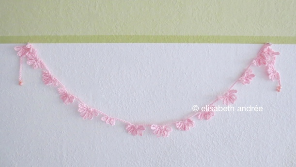 pink flowery garland on wall