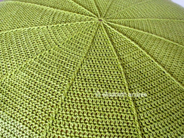 center of crochet green pouf close up