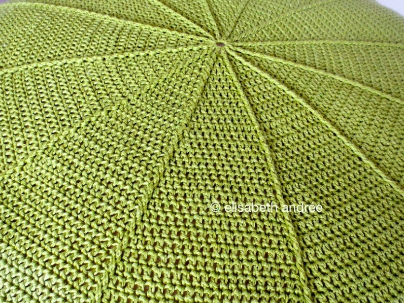 center of crochet green pouf close up