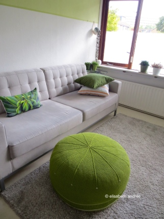 crochet green pouf 'lettuce' in front of couch