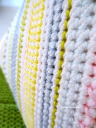 close up embroidery stitches on crochet pyramid