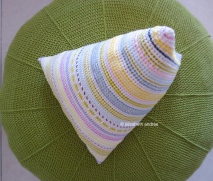 crochet pyramid cushion on top of green pouf