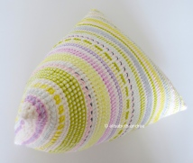 crochet pyramid cushion with embroidery by elisabeth andrée