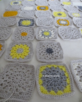 wip yellow and gray crochet squares