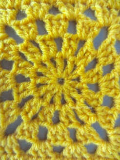 yellow crochet test square close up