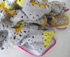 yellow, gray with bright pink crochet blanket