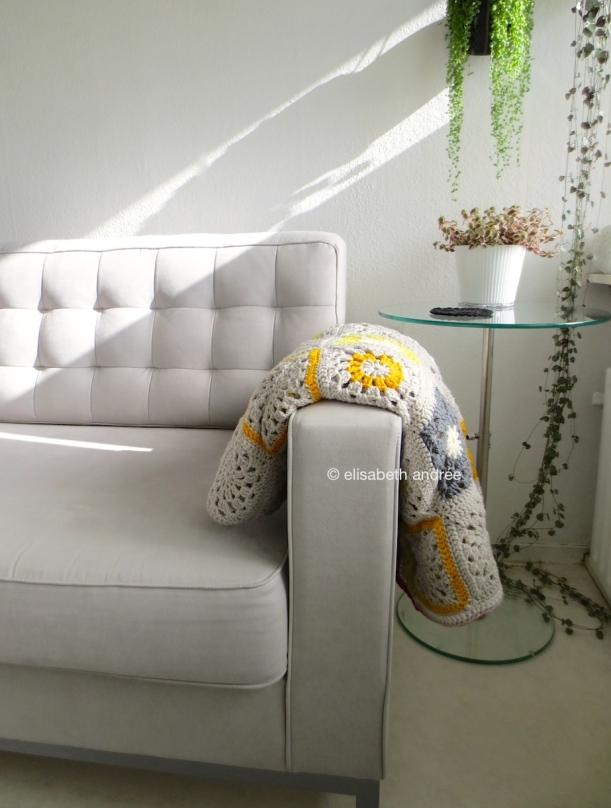 crochet yellows and grays blocks blanket folded
