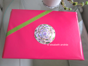 pink wrapping paper, green glitter tape and a holiday ball