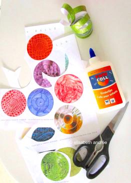 prints, glue, tape and scissors