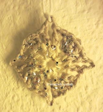 small glittery crochet square