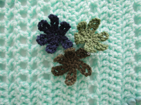 3 crochet flowers and opaline blanket