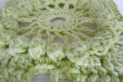 close up of pale green crochet square