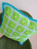 edge of lacy with dots crochet cushion cover