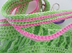 crochet green bag with bright pink details
