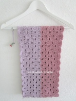 crochet stole scarf folded on hanger with pin