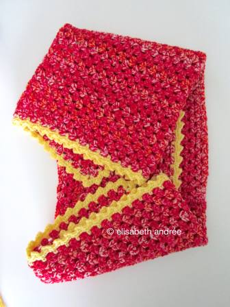 small blanket of variegated yarn folded