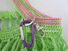 small green crochet bag with pink details and keyhangers