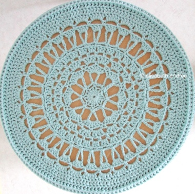 blue crochet cover for side table by elisabeth andrée