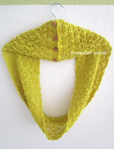 crochet yellow cowl on hanger by elisabeth andrée