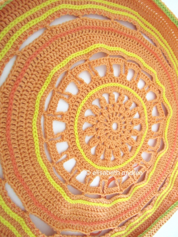 in the works crochet cushion cover in citrus hues