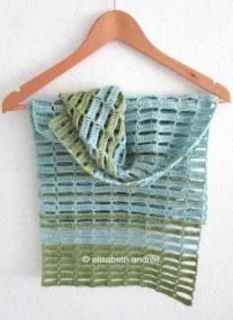 blue and green crochet work in progress by elisabeth andrée
